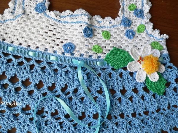 Вязанный женский свитер в косичку