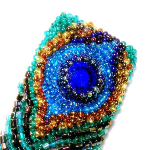 """Брошь, вышитая в стиле  """"модерн """" по схеме вышивки прошлого века.  Материалы: чешский бисер, рубка, стеклянный кристалл..."""