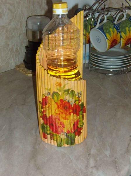 Как сделать подставку для цветов из бутылок